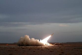 In this photo obtained from the Iranian Students News Agency, ISNA, a surface-to-air missile is fired by Iran's army, during a manoeuvre, in an undisclosed location in Iran, Tuesday. Iran said Tuesday it successfully tested a new air defense system modelled after the U.S. Hawk system during a drill in the country's east. A senior Iranian official called the six-day air defence drill over almost the entire eastern half of the country a