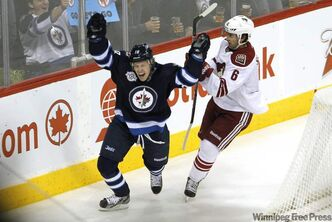 Winnipeg Jets forward Bryan Little (18) celebrates after scoring on Phoenix Coyotes goaltender Mike Smith (41) as Coyotes defenceman David Schlemko (6) looks on during first-period NHL action in Winnipeg on Thursday.