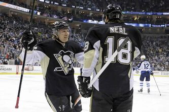 Penguins sniper James Neal (18) celebrates after his second goal.
