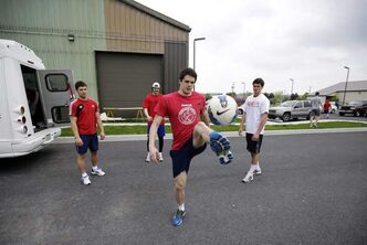 Yaroslavl Lokomotiv's Emil Galimov works on his soccer skills with teammates after a workout.