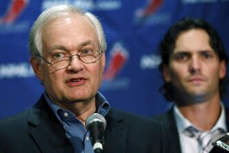 NHL Players' Association executive director Donald Fehr, center, is joined by Winnipeg Jets' Ron Hainsey as he speaks to reporters, Wednesday, Sept. 12, 2012, in New York. The NHL and the players' association swapped proposals Wednesday in an effort to head off a lockout scheduled to start this weekend. (AP Photo/Mary Altaffer)