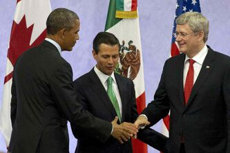 U.S. President Barack Obama, left, Mexican President Enrique Peña Nieto, and Canadian Prime Minister Stephen Harper shake hands at the end of a news conference after the seventh trilateral North American Leaders Summit Meeting in Toluca, Mexico on Wednesday. This year's theme is 'North American Competitiveness.'