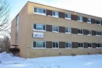 Winnipeg police are investigating what could be the first homicide of 2014 or the last homicide of 2013 after a 69-year-old man was found dead Friday in this apartment building in St. Vital.