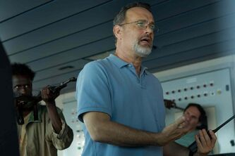 "This photo released by Sony - Columbia Pictures shows actor Tom Hanks in a scene from the film, ""Captain Phillips."" The piracy drama stars Hanks as Captain Richard Phillips who is depicted as a hero and was taken hostage by Somali pirates and later rescued by Navy SEALs."