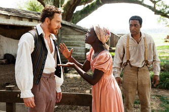 Michael Fassbender, left, Lupita Nyong'o and Chiwetel Ejiofor, right, in a scene from
