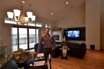 Gino's Homes sales rep Jason Topnik in the great room of his 38 Cypress Ridge show home in South Pointe, says the Spring Parade is keeping him very busy.