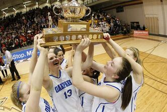 Members of the Oak Park Raiders hoist the trophy after defeating the Glenlawn Lions 71-65 to win the AAAA high school basketball championship at the University of Manitoba's Investors Group Athletic Centre Monday night.