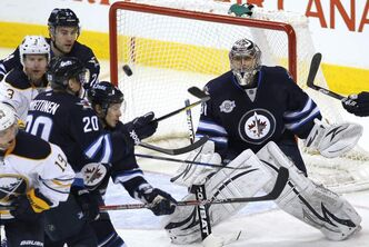 Winnipeg Jets' goaltender Ondrej Pavelec keeps his eye on a rebound off a Buffalo Sabres shot during second-period action at the MTS Centre Monday.