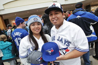 Cielo Collantes and Aiejaie Saria wait in line to get autographs from Toronto Blue Jays who are in town while on a cross-country fan appreciation tour. Organizers of the event are unofficially saying around 2500 fans showed up to get a chance to meet Jays' Brett Cecil, Aaron Loup and Jose Bautista at Polo Park mall.