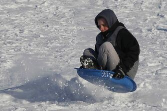 Nathan Devine was out sledding with his friends William and Daniel Friesen at Kilcona Park Sunday.