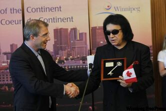 Musician Gene Simmons (right) drew a crowd at city hall. He was given the key to the city by city councillor Gord Steevs.