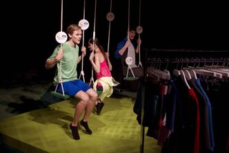 Models on swings show merchandise Target stores will stock when they open in Canada  this spring. Thursday's Toronto showcase featured Target's brands and design partners.