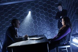 Clark Gregg, left, Brett Dalton, standing, and Chloe Bennet in Marvel's Agents of S.H.I.E.L.D.