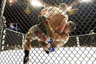 Fighters grapple during a UFC middleweight mixed martial arts match in a file photo.