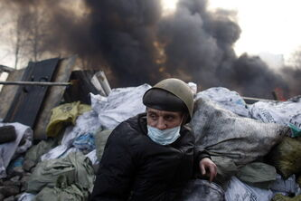 An anti-government protester mans a barricade at Independence Square in Kiev, Ukraine.