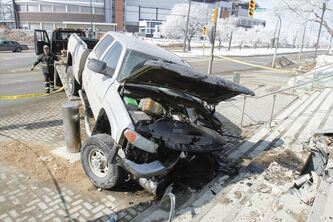 A tow truck arrived at the intersection of Chancellor Matheson Road and University Crescent around 1 p.m. on Friday to clear away a truck involved in a motor vehicle accident Friday morning. There was major damage to the stairwell at the site of the crash.