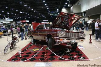 Mario Belcik's 1964 Chevrolet Impala lowrider was a popular attraction with cruisers both young and old at Piston Ring's World of Wheels.
