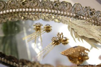 Rhinestone hair pins, $85. Dripping diamond beak hair clip, $105. From Edward Carriere.