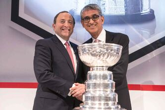 Rogers CEO Nadir Mohamed (right) and NHL commissioner Gary Bettman announce the mega broadcasting deal Nov. 26, 2013. The CBC is the big loser.