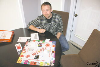 North Kildonan resident Willi Penner with his game Mathopoly.