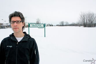 Peter Okolita stands next to the city's sign for Okolita Park in south St. Vital.