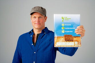 Woody Harrelson holds a package of Prairie Pulp and Paper's Step Forward paper.