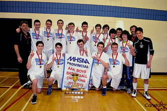 The Westgate Wings celebrate their provincial AAA basketball championship.