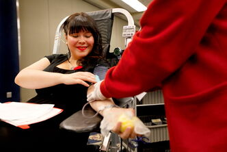 Mindy McKenzie gives blood at a 2011 Red Cross Blood Donor Clinic set up at the Convention Centre.