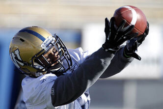 Bombers' Wallace Miles brings in a pass during practice at Canad Inns Stadium on Saturday.
