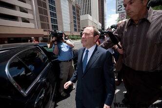 NHL commis­sioner Gary Bettman ap­pears upbeat as he leaves U.S. Bankruptcy Court in Phoenix Tuesday.