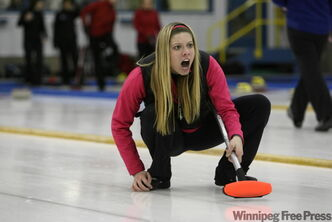 Holly Scott yells out sweeping instructions to her teammates after throwing her last rock of the end at Fort Garry Curling Club Sunday morning.