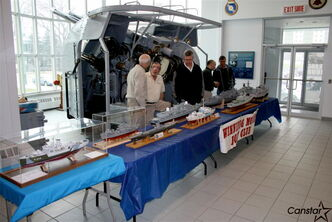 Winnipeg Model Boat Club members with a display on board HMCS Chippewa.