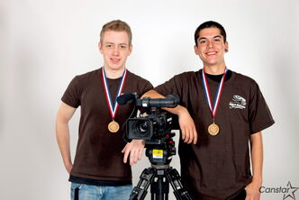 Jordan Mack and Brenden Moreira wearing their gold medals from the Skills Canada Provincial Competition.  They competed in TV and Video Production.