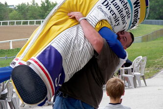 Hug and get hugged by mascots on Canada Day as Free Press mascot Scoop did at a previous event.