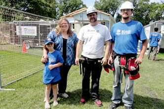 MLA Matt Wiebe (centre) with the Van De Keere family at the Habitat for Humanity build in Memorial Park last year.