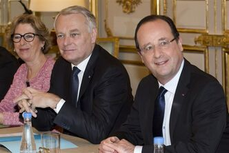 French President Francois Hollande, right, Prime Minister Jean Marc Ayrault, center, and Research Minister Genevieve Fioraso poses for photographers in Paris on April 19, 2013. THE CANADIAN PRESS/AP, Jacques Brinon