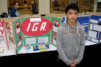 Maples Collegiate student Rex Sauddin stands by his display at the Maples Career Start Project Fair held at Garden City Shopping Centre Jan. 24.