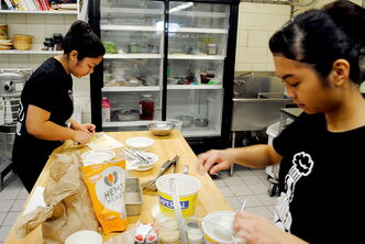 Members of the Sisler Squashers prepare their squash-getti casserole during the Localvore Iron Chef Cook-Off.