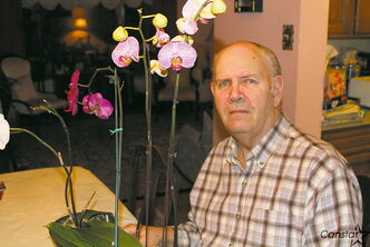 Fraser Cameron of Manitoba Orchid Society, shows off his prize orchids, some of which will be on display at the society's Show and Sale, March 22-24.