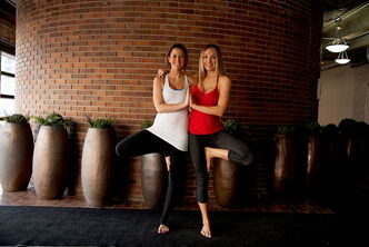 Left: Rachelle Taylor, Prairie Yogi Magazine founder and director of business development, strikes a yoga pose with Monique Pantel, creative director.