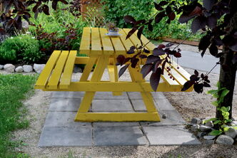 This yellow table, simple though it may be, has become a focal point in the neighbourhood.