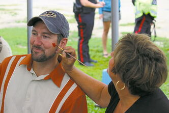 St. Norbert MLA Dave Gaudreau gets his face painted at last year's community barbecue at St. Norbert Farmers' Market. This year's event is set for June 23.