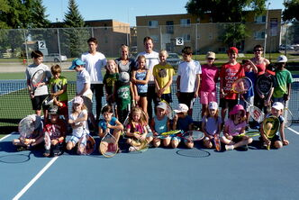 Tennis instructor Brian Pound with some of the many kids who attended a recent tennis camp through the Norwood Tennis Program.