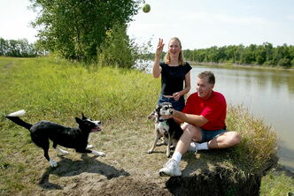 Laura and Chuck Ross are pictured with dogs Paige and Crystal at Maple Grove Park in a file photo. The Maple Grove Park Dog Owners' Association is holding a fall barbecue at the park on Sept. 22.