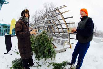 Hut designers Mamie Griffith and Richard Kroeker assemble Kroeker's winning 2010 warming hut design Fir Hut at The Forks.