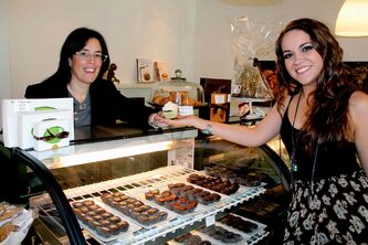 Constance Menzies (left) hands a tasty treat to local  musician Sierra Noble.