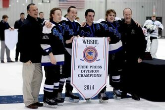 (Left) The Winnipeg High School Hockey League's Mike Macwilliam, Sanford  Sabres players Chad Millar, Riley Poole, Steve Young and Chase Kendall and WHSHL president Mark Miles pose with the 2014 Free Press Division banner after the Sabres defeated the Lord Selkirk Royals on March 12.