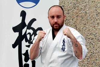 Sean Devlin with the kyokushin banner.