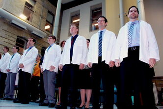 New U of M medical students stand proudly before friends and family Wednesday afternoon after their white coat ceremony in the Brodie Centre atrium at the university's Bannatyne campus.