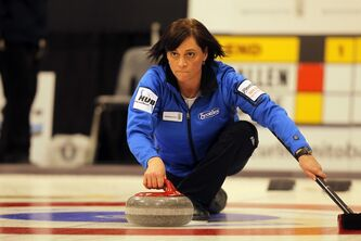 Colleen Kilgallen delivers a rock Friday's 4 p.m. draw.